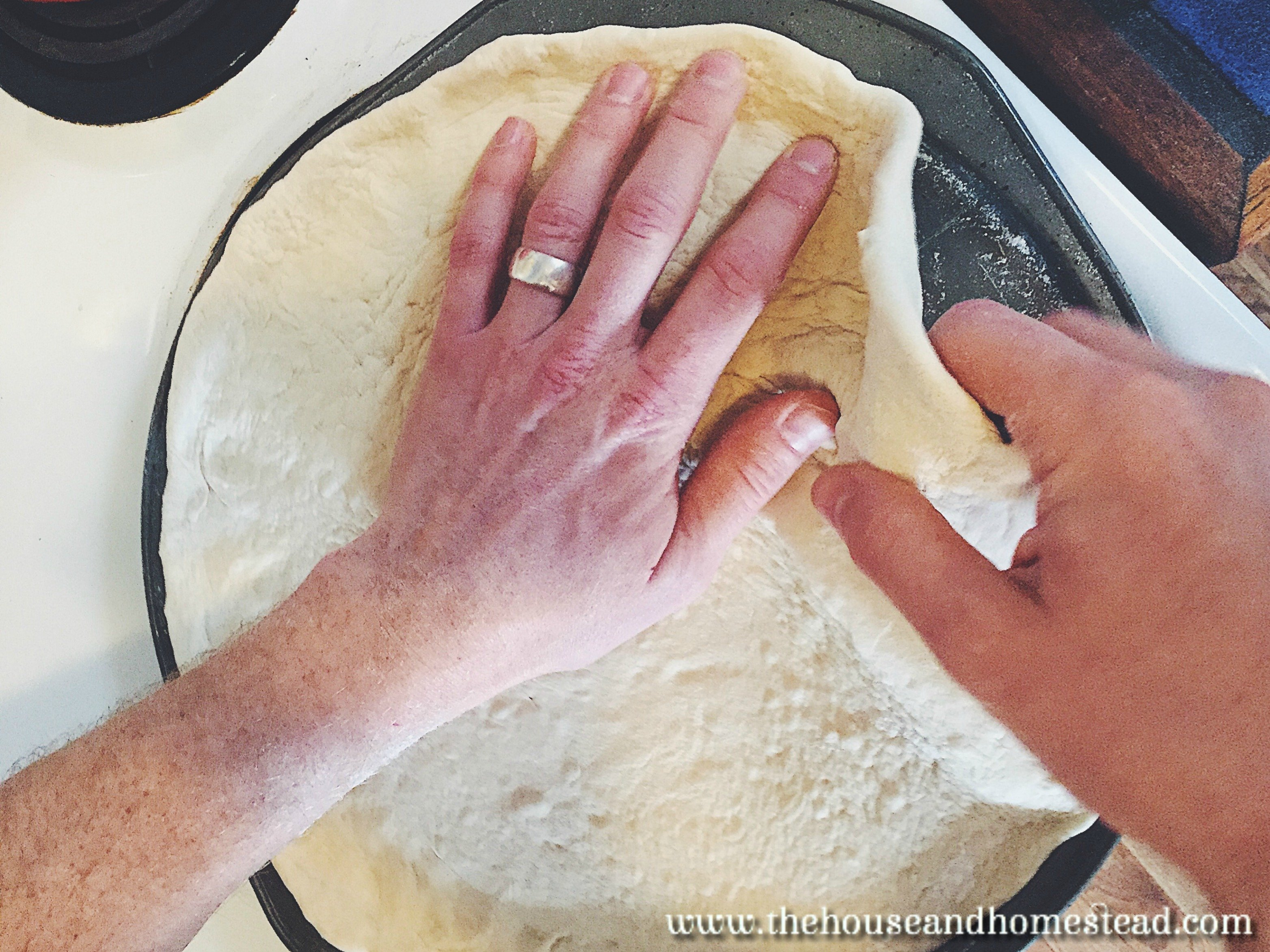 Perfect, easy homemade pizza dough for a perfect pizza crust. You'll never spend money on takeout pizza again once you've tried this super simple pizza dough recipe. #pizzadough #pizzacrust #homemadepizza