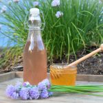 This honey and chive blossom vinaigrette is a frugal, easy and healthy homemade salad dressing that pairs beautifully with fresh garden salads all season long. #chiveblossomvinaigrette #chiveblossomrecipe #chiveblossomvinegar
