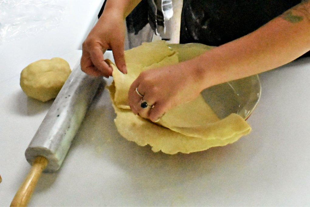 Folding pie dough.