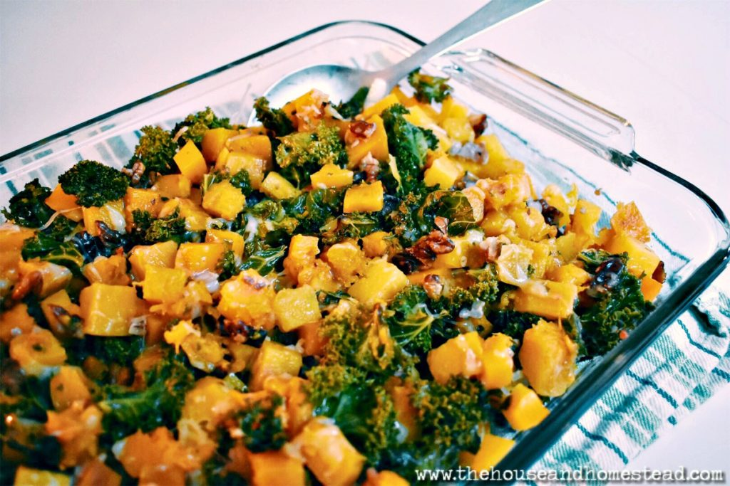 This butternut squash and kale casserole turns simple ingredients into nutritious comfort food that can be enjoyed either as a side dish or a stand-alone meal. A perfect warm and comforting dish for a cold fall or winter day or night!  #butternutsquashrecipes #butternutsquashcasserole #butternutsquash