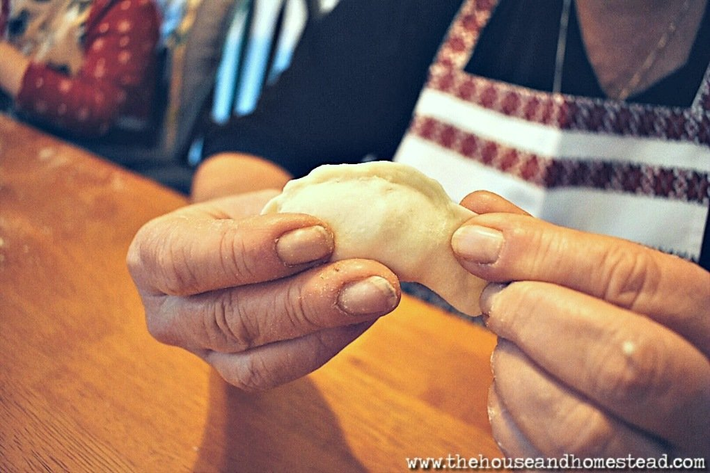 These traditional Ukrainian perogies are made from scratch with simple ingredients and cost just pennies a piece. This perogies recipe makes enough to feed a large family and put some away in the freezer for later. A great frugal food to fill your belly and make your dollars stretch! #perogies #perogiesrecipe #ukrainianperogies #frugalfood #freezercooking #ukrainianfood