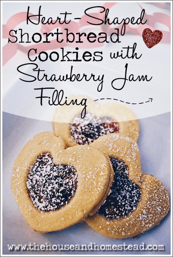 These heart-shaped shortbread cookies are buttery and crumbly with a sweet and sticky strawberry jam filling. The best Valentine's Day cookies! #heartshapedcookies #heartshapedshortbreadcookies #valentinecookies #valentinescookies