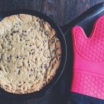 If you're looking for the perfect homemade treat to satisfy your sweet tooth, look no further than this ooey, gooey chocolate chip skillet cookie recipe. It's rich and indulgent and totally decadent, and it will satisfy your sweet tooth like no other desert can! #skilletcookie #chocolatechipskilletcookie