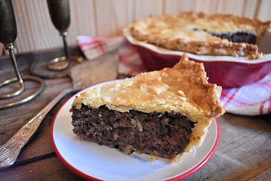 This traditional tourtière recipe makes it easy to bring this classic French-Canadian Christmas meat pie to the dinner table at Christmas or any time of year. #tourtiere #tourtiererecipe #meatpie #christmaspie