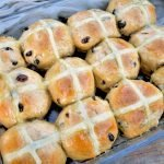 Hot cross buns are synonymous with Easter. Learn how to make your own homemade hot cross buns from scratch and you may never buy them from the store again! #hotcrossbuns #hotcrossbunsrecipe #easterrecipes #eastertreats #easterdesserts
